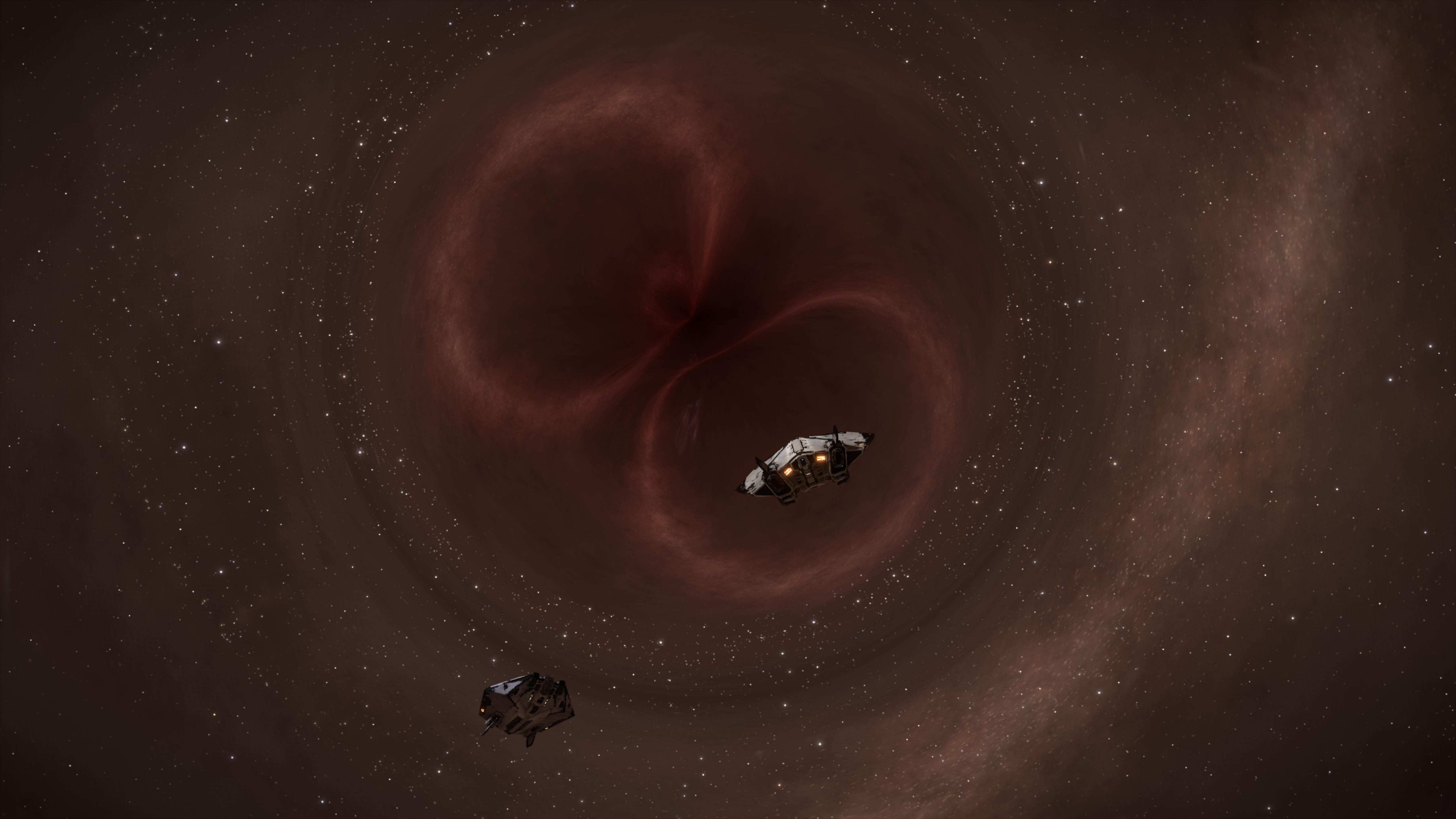 The supermassive black hole that is Sag A* with our ships in front